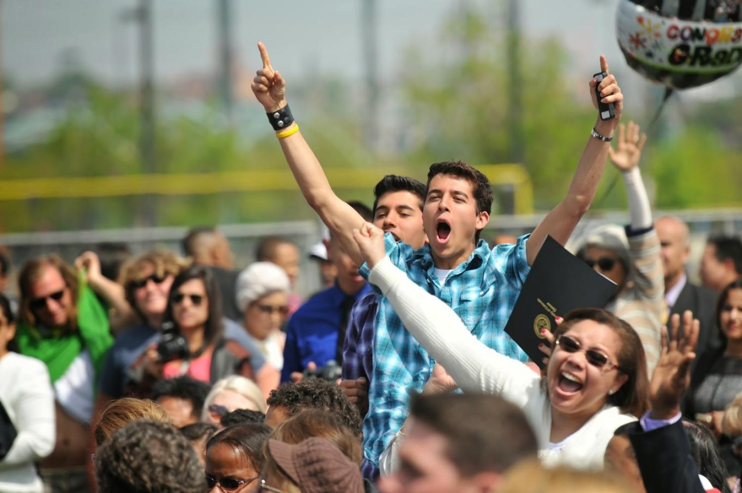 Photo of cheering at commencement
