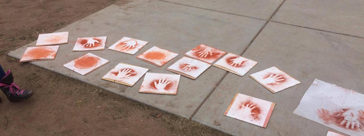 artistic designs spread out on the ground