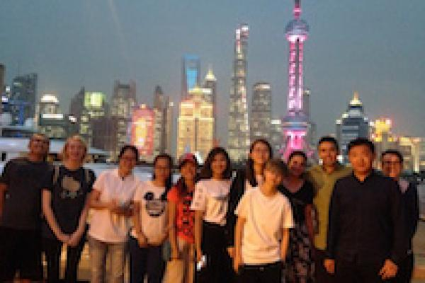 Photo of students in front of Shanghai skyline