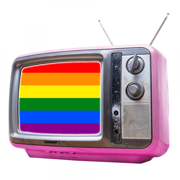 An old television in draped in a rainbow flag