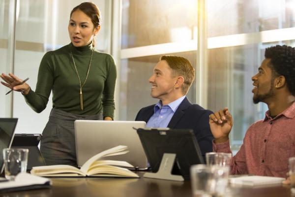 3 people in a workshop