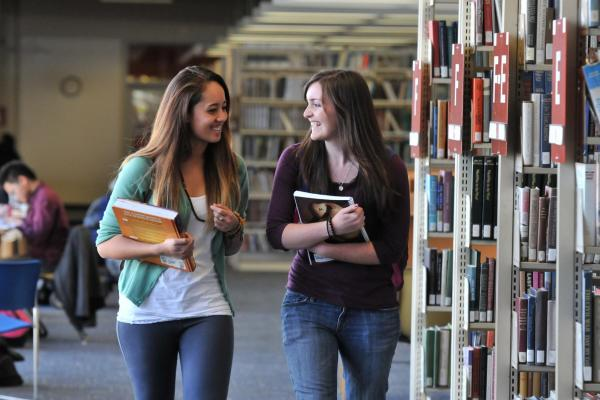 two girls in library