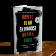 Ibram Kendi's book How to be an Antiracist standing up and partially open on a table.
