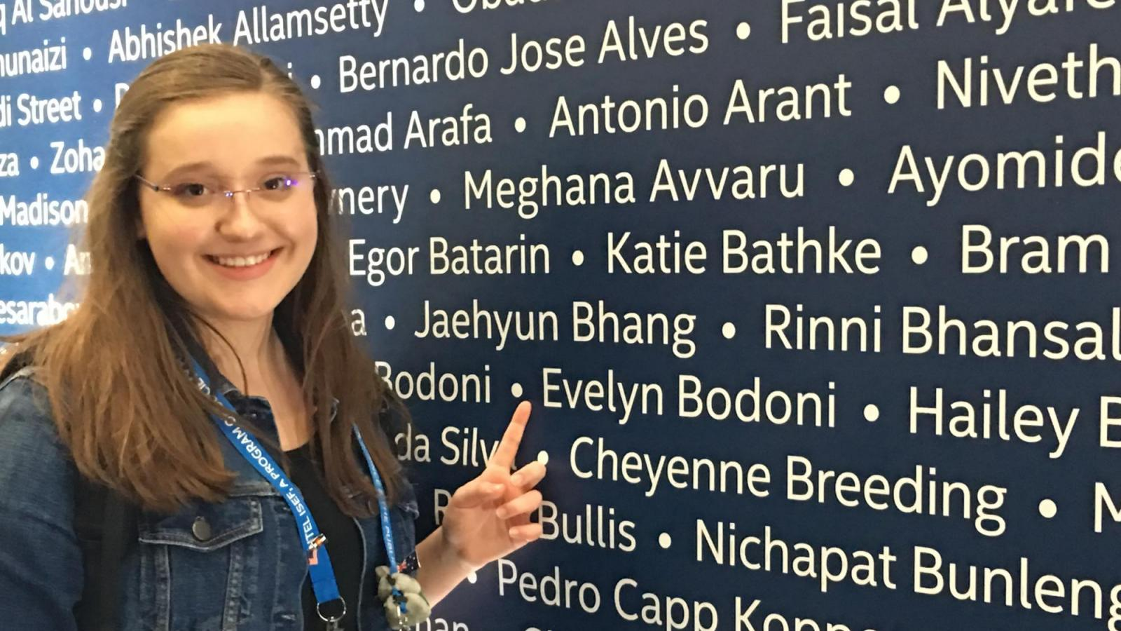 Evelyn Pointing at Her Name at the 2018 ISEF Registration