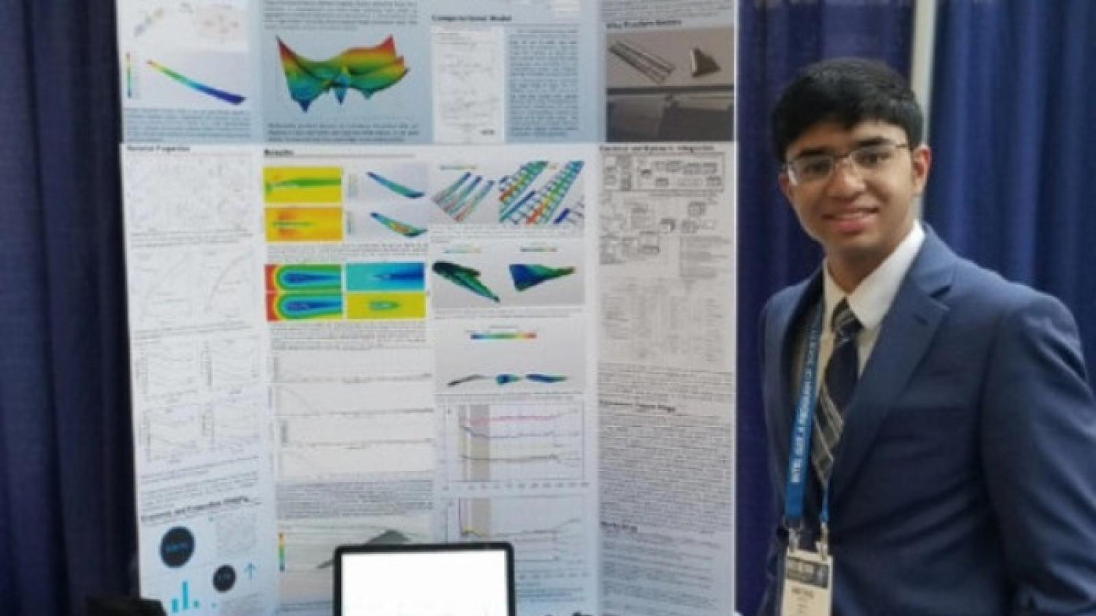 Krithik Remesh with poster board at 2018 ISEF Competition