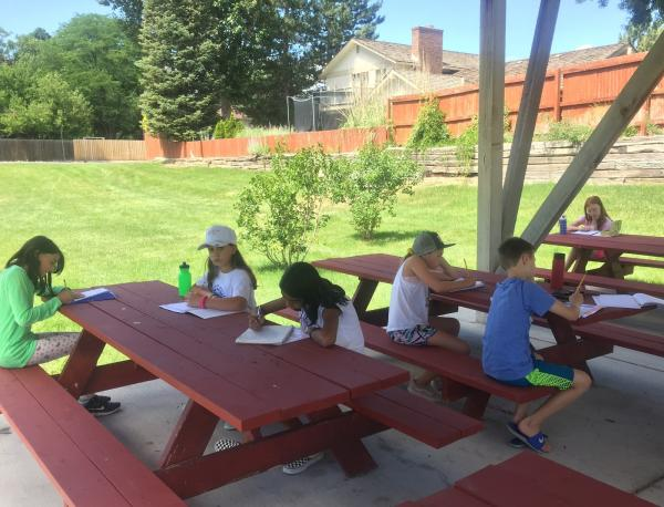 Cherry creek writers working at a picnic table