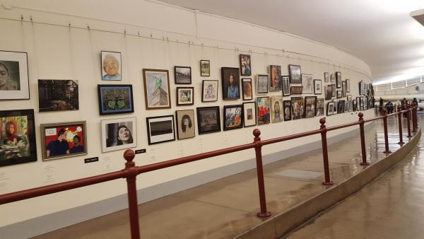 Hall in the Capital showing framed art displayed on the wall.