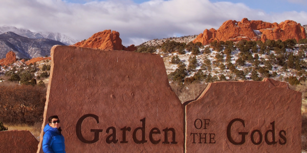Example of an informative image - Chemistry Professor standing near the Garden of the Gods park sign.