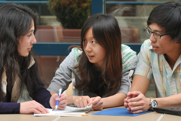 Students discussing economic principles