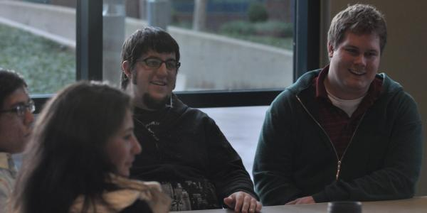 Four students in a meeting