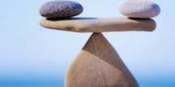 Rocks on balancing scale