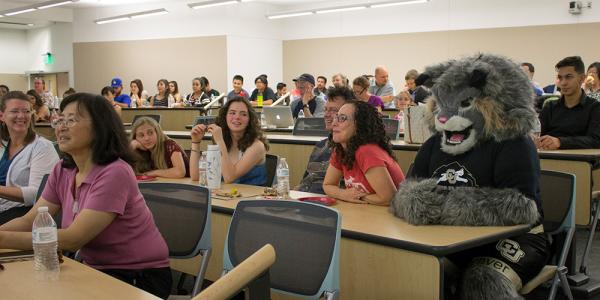 Students in class with Lynx mascot