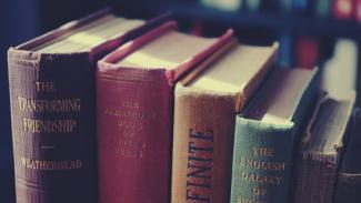 Closeup image of books on a shelf