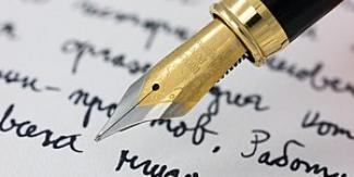 Old fashioned pen writing on paper