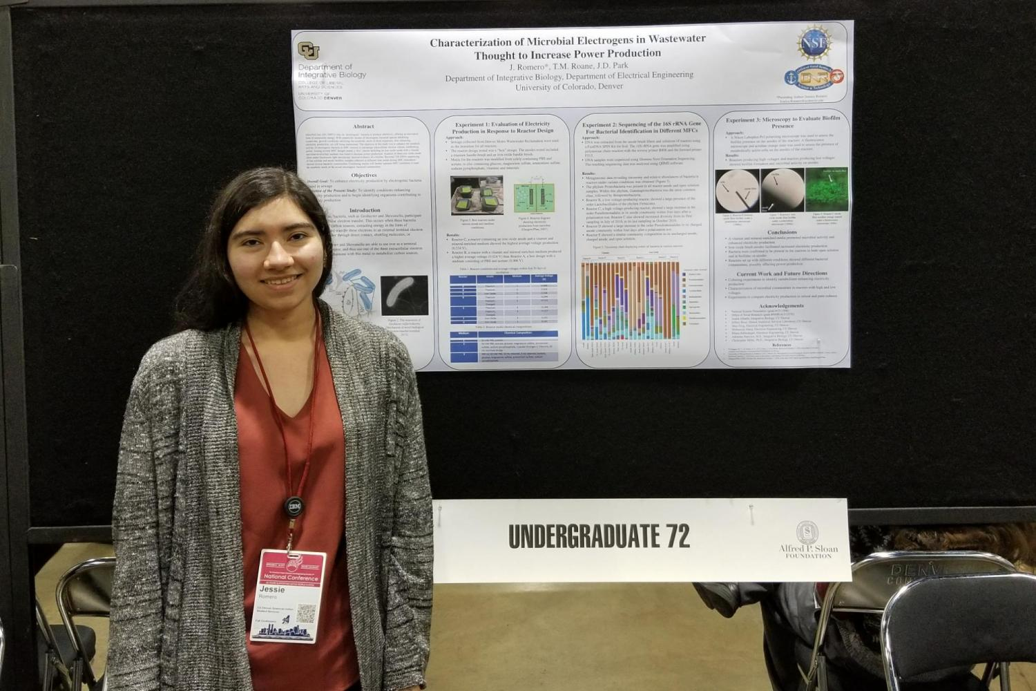 Biology student presenting research poster
