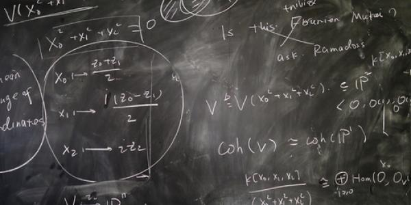 Photo of chalkboard with mathematical expressions on it