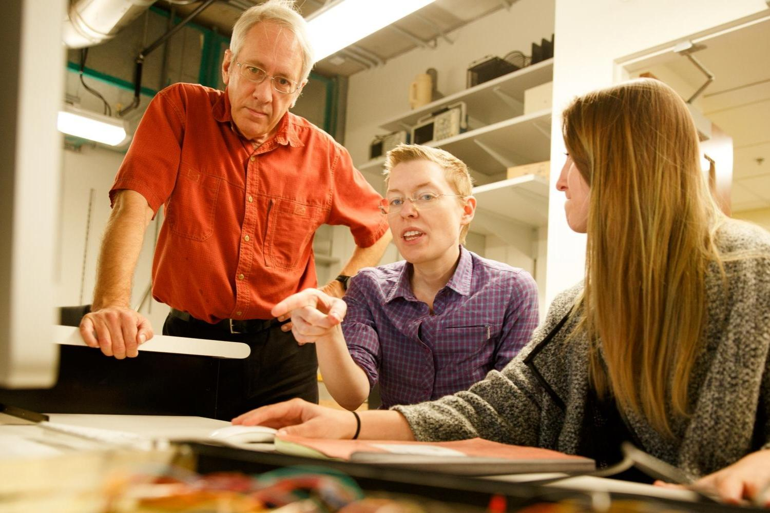 Photo of Professor Martin Huber from Physics with students.