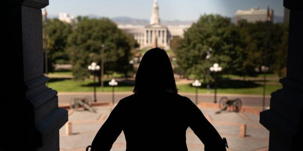 A woman in downtown Denver stands on capitol hill