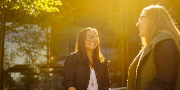 Two women having an outdoor conversation