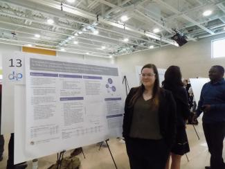 Kate Fitch next to poster