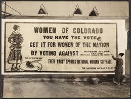 Women's sign that encourages women of Colorado to help women in other states to get the right to vote