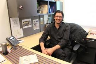 Photo of Dr. Ryan Crewe at his desk
