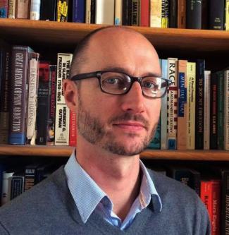 Head shot photo of Dr. Brandon Mills