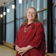 Dr. Hunt smiling in the halls of CU Denver.