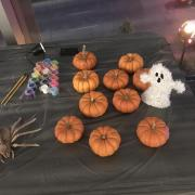 Photo of the pumpkin painting table at the Phi Alpha Theta Halloween event