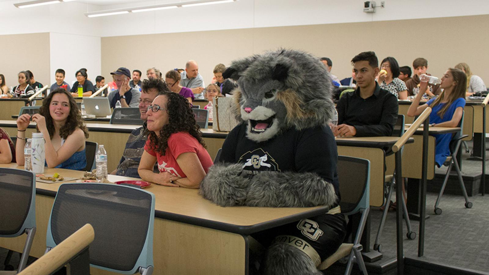 students in class with mascot Milo the Lynx