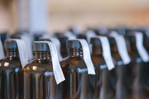 rows of brown bottles of biology materials