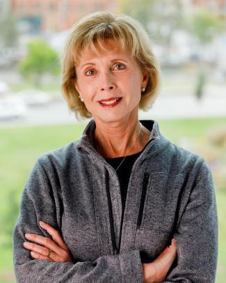 Profile portrait of Diana Tomback.