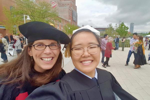 Dr. Mosier celebrating with graduating student researcher