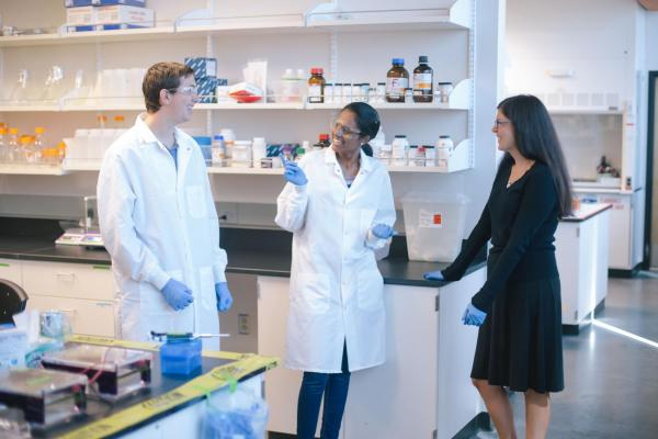Dr. Mosier with students in the lab