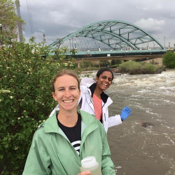 Research team members posing by the water