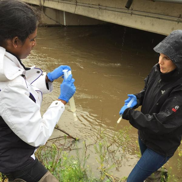 Dr. Mosier with student researcher collecting samples