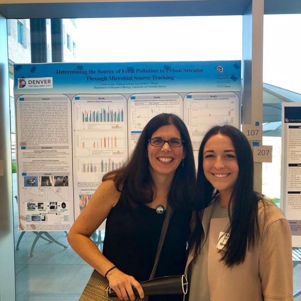 Dr. Mosier and student researcher presenting a research poster