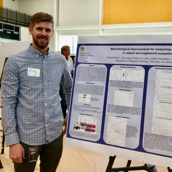 Student researcher presenting research poster