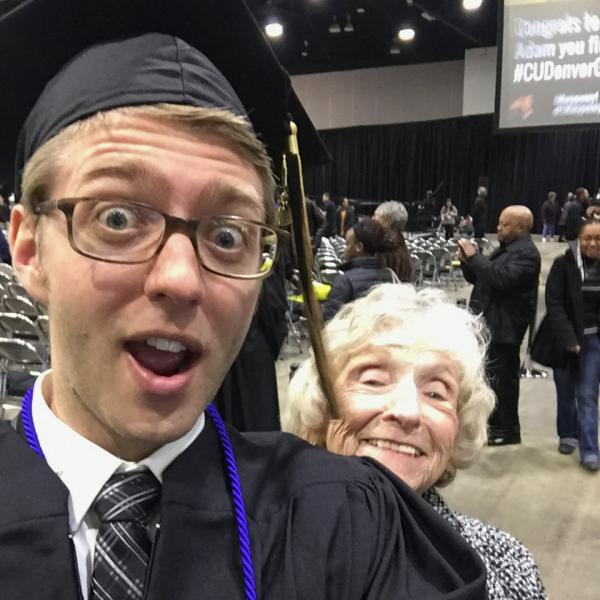 Graduating student researcher taking a selfie