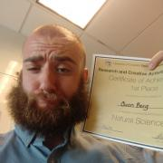 Owen Berg winning 1st Place in Natural Sciences at RaCAS