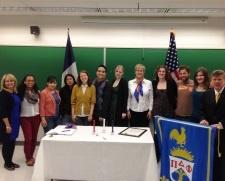 Group photo taken at CU Denver's chapter of Pi Delta Phi's sanctioning ceremony