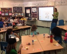 GES faculty member giving a talk to an elementary school class