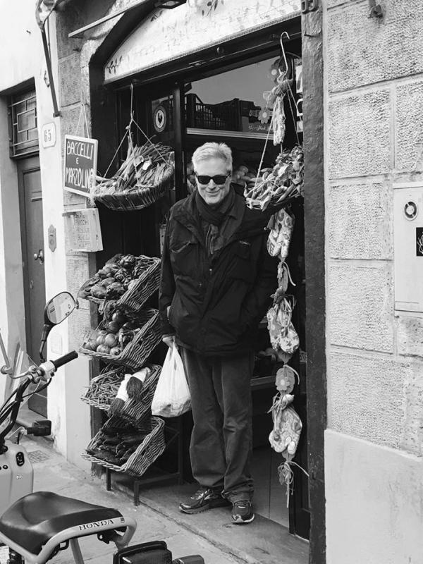 Professor Harvey Bishop in front of a shop in black and white