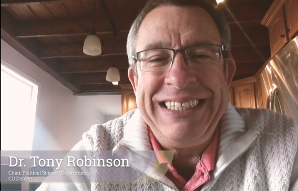 Dr. Tony Robinson, Political Science Department Chair at table still from video.