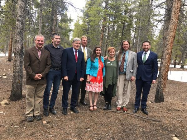 The photo shows Professor Walsh standing in Leadville's Evergreen Cemetery last May with Irish Ambassador Daniel Mulhall (red tie), Irish Consular General Adrian Farrell (green tie),  Leadville Mayor (standing in back), and members of the local Irish Network planning team.