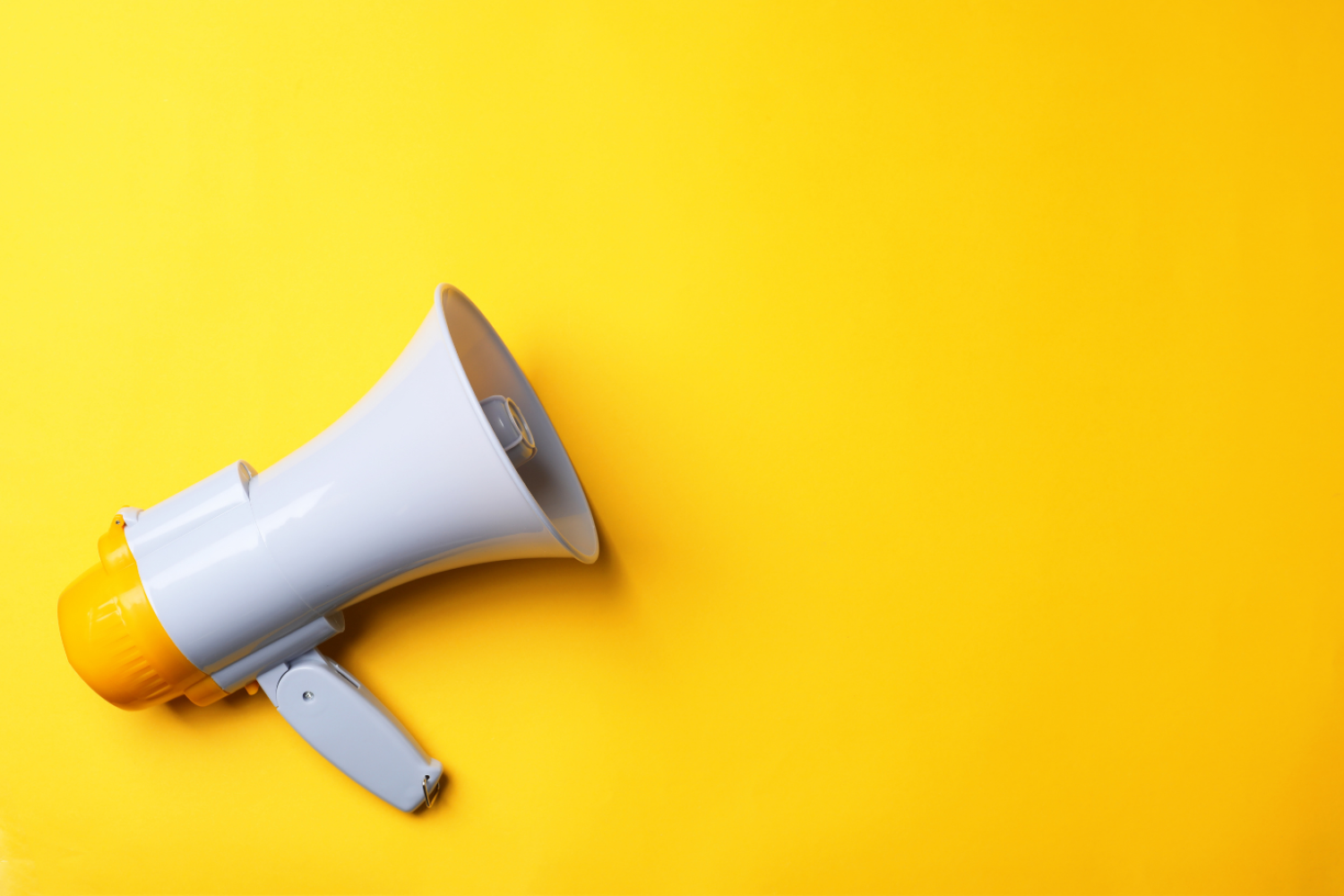 Yellow background with megaphone facing to the right