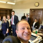 Jared Polis appears in selfie with former staffers