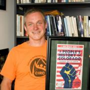 Dr. James Walsh with Poster A People's History of Colorado - Photo: Ryan Egloff· The Sentry