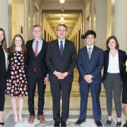 Group of 7 student interns with Senator Michael Bennet center