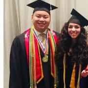 Johnnie Nguyen and Mena Hashim find President Bruce Benson during graduation ceremonies.